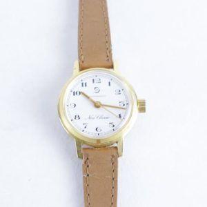 montre or dorée vintage seconde main chic élégant cadran bracelet fin moderne nude chair