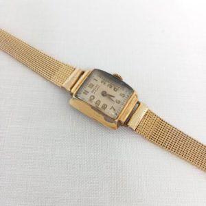 montre or dorée vintage seconde main chic élégant cadran bracelet fin rectangle